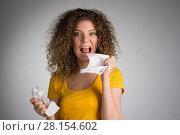 Купить «woman furiously tore the paper», фото № 28154602, снято 29 января 2018 г. (c) Типляшина Евгения / Фотобанк Лори