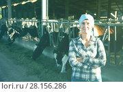 Купить «Portrait of woman who is standing near cows», фото № 28156286, снято 24 октября 2017 г. (c) Яков Филимонов / Фотобанк Лори