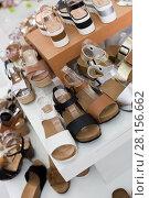 Купить «Picture of shelves with summer footwear», фото № 28156662, снято 17 августа 2017 г. (c) Яков Филимонов / Фотобанк Лори