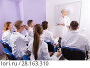 Купить «Professor giving presentation for medical students», фото № 28163310, снято 5 октября 2017 г. (c) Яков Филимонов / Фотобанк Лори