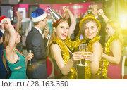Купить «Young friends dancing on new year party», фото № 28163350, снято 20 апреля 2017 г. (c) Яков Филимонов / Фотобанк Лори