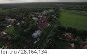 Купить «Russian Lukino village with Holy Cross Monastery and Ascension Cathedral, aerial», видеоролик № 28164134, снято 27 февраля 2018 г. (c) Данил Руденко / Фотобанк Лори