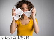 Купить «woman furiously tore the paper», фото № 28170510, снято 29 января 2018 г. (c) Типляшина Евгения / Фотобанк Лори