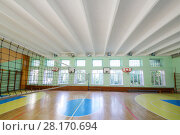 Купить «MOSCOW, RUSSIA - JUN 28, 2016: Gym with volleyball net in 2107 school, In Moscow there are more than 1800 schools», фото № 28170694, снято 28 июня 2016 г. (c) Losevsky Pavel / Фотобанк Лори