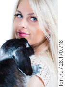 Купить «Cute young blonde hugs funny black rabbit isolated on white, close up», фото № 28170718, снято 20 ноября 2015 г. (c) Losevsky Pavel / Фотобанк Лори