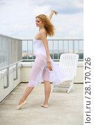 Купить «Beautiful girl in white dancing near sunbed on the roof of a multistory building», фото № 28170726, снято 30 июля 2015 г. (c) Losevsky Pavel / Фотобанк Лори