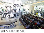 Купить «Modern gym with new shiny fitness equipment, big mirror, dumbbell set for sport training», фото № 28170798, снято 29 июня 2016 г. (c) Losevsky Pavel / Фотобанк Лори