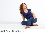 Купить «Happy pretty barefoot woman in jeans poses on floor in white studio», фото № 28170970, снято 20 ноября 2015 г. (c) Losevsky Pavel / Фотобанк Лори