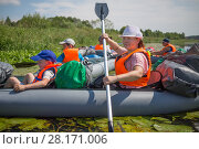 Купить «Three adults and two children in life jackets are on inflatable boats during hike at summer», фото № 28171006, снято 2 июля 2016 г. (c) Losevsky Pavel / Фотобанк Лори