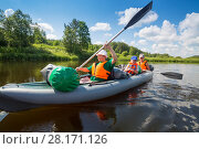 Купить «Two women with oars and little boy sail on inflatable boats on river at sunny summer day», фото № 28171126, снято 3 июля 2016 г. (c) Losevsky Pavel / Фотобанк Лори