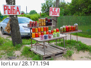 Selling pickles in village - many glass jars with mushrooms, vegetables in village, red text translation - fish, fish. Стоковое фото, фотограф Losevsky Pavel / Фотобанк Лори