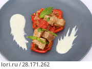 Купить «Pieces of roasted meat on on sliced red bell pepper on a grey plate», фото № 28171262, снято 7 июля 2016 г. (c) Losevsky Pavel / Фотобанк Лори