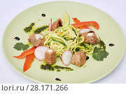 Купить «Plate of spaghetti with roasted meat and slices of radish, red pepper, lime and herbs», фото № 28171266, снято 7 июля 2016 г. (c) Losevsky Pavel / Фотобанк Лори