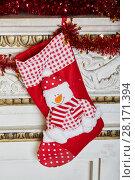 Купить «Gift boot hang on mantelshelf decorated to christmas holidays», фото № 28171394, снято 9 декабря 2015 г. (c) Losevsky Pavel / Фотобанк Лори