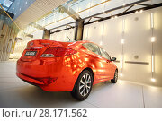 Купить «MOSCOW - APR 16, 2016: Red Hyundai Solaris model are on wall in Hyundai Motorstudio. Hyundai produces not only cars, but also its own collection of furniture and household items», фото № 28171562, снято 16 апреля 2016 г. (c) Losevsky Pavel / Фотобанк Лори