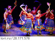 MOSCOW, RUSSIA - MAY 21, 2016: Girls in blue plaid skirts dance on stage during concert of dance studio Firebird in Bogorodskoye. Редакционное фото, фотограф Losevsky Pavel / Фотобанк Лори