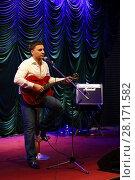 Купить «MOSCOW - APR, 16, 2016: Yugorsky Alexander singing and playing guitar in jazz club Kino», фото № 28171582, снято 16 апреля 2016 г. (c) Losevsky Pavel / Фотобанк Лори