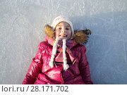 Купить «Little beautiful girl is laying on the back at rink», фото № 28171702, снято 3 января 2015 г. (c) Losevsky Pavel / Фотобанк Лори