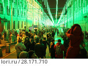 Купить «RUSSIA, MOSCOW - 03 JAN, 2015: People are walking in the decorated with glitter garlands boulevard near theater Moscow operetta», фото № 28171710, снято 3 января 2015 г. (c) Losevsky Pavel / Фотобанк Лори