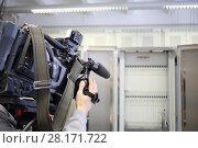 Купить «Operator is recording video at communications room in city telephone network», фото № 28171722, снято 25 апреля 2016 г. (c) Losevsky Pavel / Фотобанк Лори