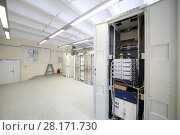 Купить «Telecom equipment with many cables and switches in big communication center», фото № 28171730, снято 25 апреля 2016 г. (c) Losevsky Pavel / Фотобанк Лори