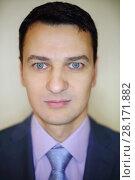 Купить «Handsome brunet man in business suit with tie in studio, close up portrait», фото № 28171882, снято 28 апреля 2016 г. (c) Losevsky Pavel / Фотобанк Лори