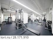 Купить «New and light fitness center with many modern sport equipment», фото № 28171910, снято 27 сентября 2016 г. (c) Losevsky Pavel / Фотобанк Лори