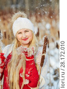 Купить «Smiling woman stands on frozen pond among flying reeds fluff», фото № 28172010, снято 15 января 2016 г. (c) Losevsky Pavel / Фотобанк Лори