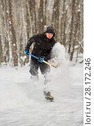 Купить «Hockey player runs throwing up puck and snow at outdoor skating rink in park», фото № 28172246, снято 21 января 2016 г. (c) Losevsky Pavel / Фотобанк Лори