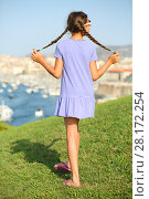 Купить «Girl walks on lawn on hill with views of old port Marseille, France, back view», фото № 28172254, снято 30 июля 2016 г. (c) Losevsky Pavel / Фотобанк Лори