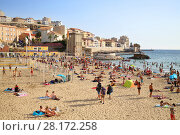 Купить «MARSEILLE, FRANCE - JUL 30, 2016: People relax on sandy beach. Marseille - largest port of France located on Mediterranean sea», фото № 28172258, снято 30 июля 2016 г. (c) Losevsky Pavel / Фотобанк Лори