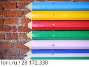 Купить «Street bench made from big multicolor pencils, close-up view», фото № 28172330, снято 30 октября 2015 г. (c) Losevsky Pavel / Фотобанк Лори
