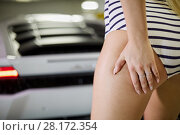 Купить «Closeup female hand touching buttock against white car at underground parking», фото № 28172354, снято 2 июня 2016 г. (c) Losevsky Pavel / Фотобанк Лори