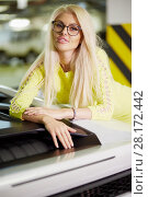 Купить «Smiling blonde woman in yellow dress stands leaning on trunk of modern white car at underground parking», фото № 28172442, снято 2 июня 2016 г. (c) Losevsky Pavel / Фотобанк Лори