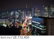 Купить «SEOUL - NOV 02, 2015: Panorama of city area with street traffic and TV tower at night», фото № 28172450, снято 2 ноября 2015 г. (c) Losevsky Pavel / Фотобанк Лори