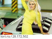 Купить «Young smiling woman in yellow dress stands leaning back onto trunk of modern white car at underground parking», фото № 28172502, снято 2 июня 2016 г. (c) Losevsky Pavel / Фотобанк Лори