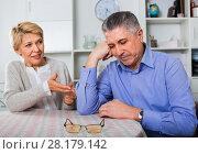 Купить «Mature couple decide family matters and find out relationship», фото № 28179142, снято 3 августа 2020 г. (c) Яков Филимонов / Фотобанк Лори