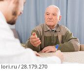 Купить «Retired and social employee fill form», фото № 28179270, снято 17 июня 2019 г. (c) Яков Филимонов / Фотобанк Лори