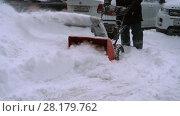 Купить «Man with a snow blowing machine working», видеоролик № 28179762, снято 1 марта 2018 г. (c) Игорь Жоров / Фотобанк Лори
