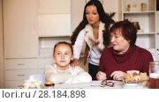 Купить «Portrait of upset little girl scolded by mother and grandma at home», видеоролик № 28184898, снято 27 ноября 2017 г. (c) Яков Филимонов / Фотобанк Лори