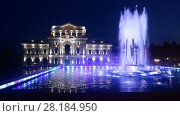 Купить «Night view of Culture Palace and colored fountain in Drobeta Turnu-Severin», видеоролик № 28184950, снято 23 октября 2017 г. (c) Яков Филимонов / Фотобанк Лори
