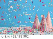 Купить «birthday hat and confetti on blue background», фото № 28188902, снято 3 марта 2018 г. (c) Майя Крученкова / Фотобанк Лори