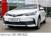 Купить «Toyota Corolla in front of the motor show», фото № 28189822, снято 7 июня 2017 г. (c) Евгений Ткачёв / Фотобанк Лори
