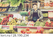 Купить «Male shopping assistant weighing grapes in grocery shop», фото № 28190234, снято 18 марта 2017 г. (c) Яков Филимонов / Фотобанк Лори