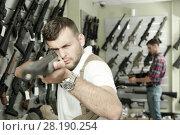 Купить «Man choice pneumatic gun», фото № 28190254, снято 4 июля 2017 г. (c) Яков Филимонов / Фотобанк Лори