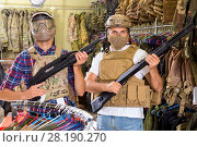 Купить «Male customers try on ammunition with weapon», фото № 28190270, снято 4 июля 2017 г. (c) Яков Филимонов / Фотобанк Лори
