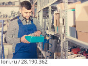 Купить «Charming male worker looking through sanitary drain pipes», фото № 28190362, снято 15 марта 2017 г. (c) Яков Филимонов / Фотобанк Лори