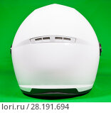 Купить «White motorcycle helmet, rear view, green background, close up», фото № 28191694, снято 27 февраля 2018 г. (c) Кекяляйнен Андрей / Фотобанк Лори