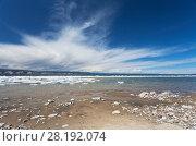 Купить «Lake Baikal on a spring day. Beautiful clouds over the Maloye More Strait. Sandy coast of Olkhon Island during the melting of ice», фото № 28192074, снято 22 мая 2011 г. (c) Виктория Катьянова / Фотобанк Лори