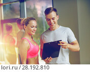 Купить «smiling young woman with personal trainer in gym», фото № 28192810, снято 29 июня 2014 г. (c) Syda Productions / Фотобанк Лори